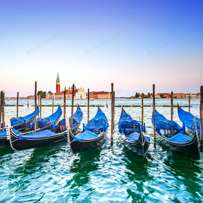 Venice sunset, gondolas or gondole and church on background. Italy