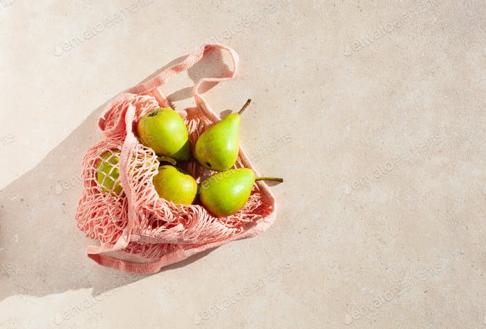 fruits pears in reusable mesh cotton bag, plastic free zero waste concept