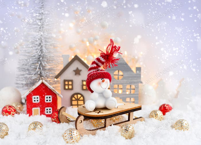 Christmas composition with the snowman on sleigh and festive decorations