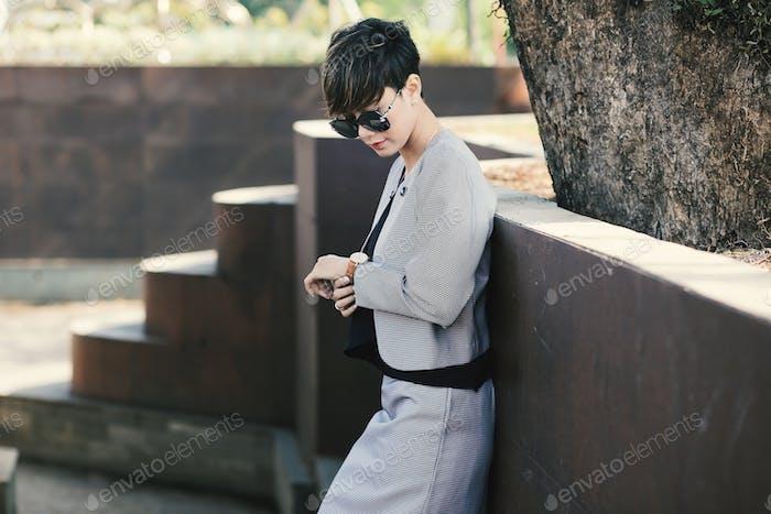 Business Woman looking wristwatch