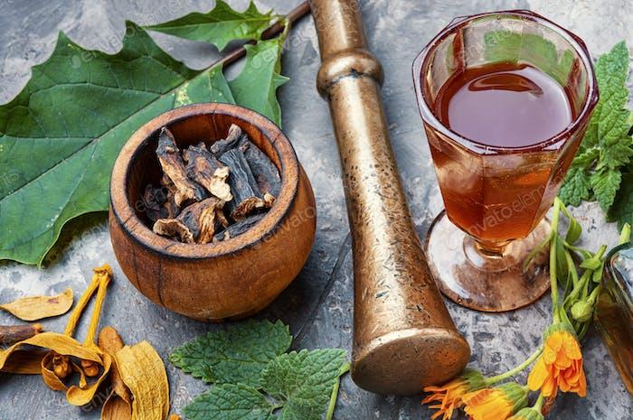Healing herbs and bottle of elixir
