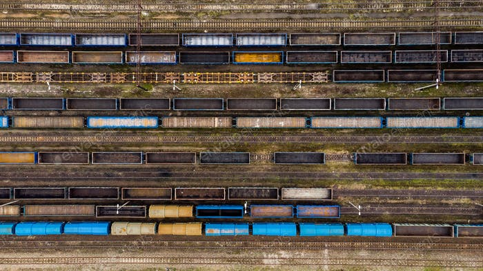 Aerial view of colorful freight trains on the railway station.
