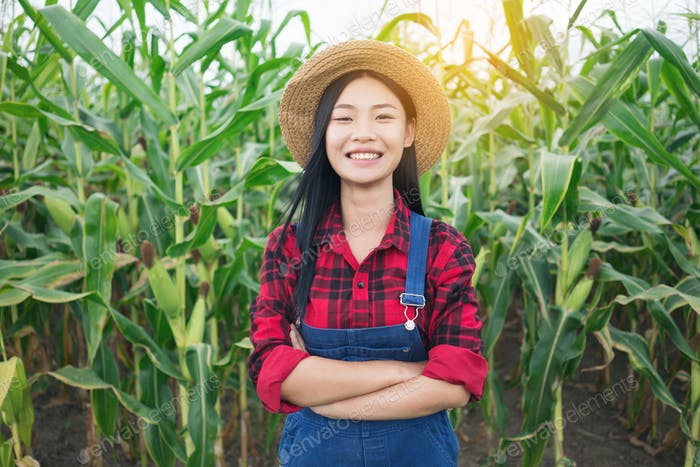 Happy farmer in the corn field