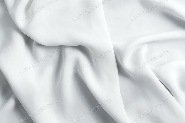 Crumpled textile fabric background of light grey color