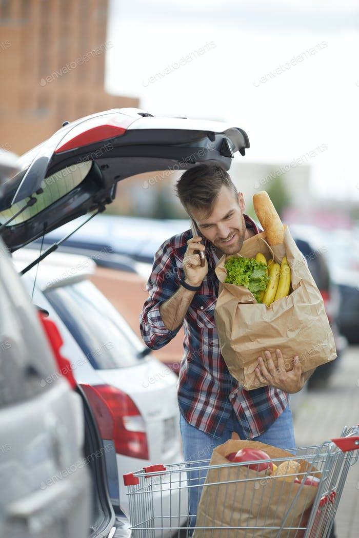 Man Packing Groceries