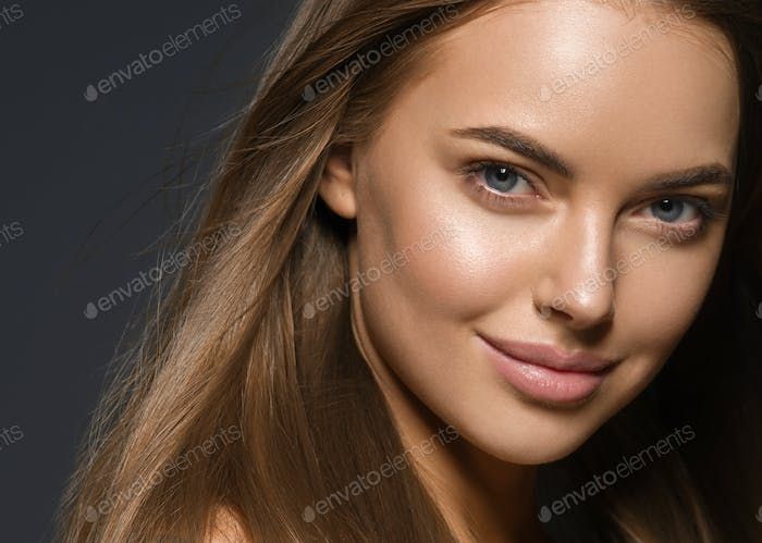 Woman face close up skin tone beautiful eyes smile lips