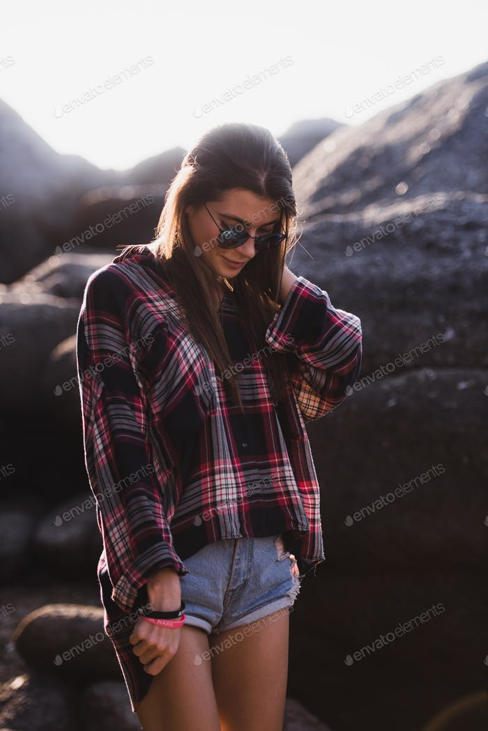 Outdoor fashion image of stylish young lady,fashionable.Lifestyle portrait of stunning hipster girl