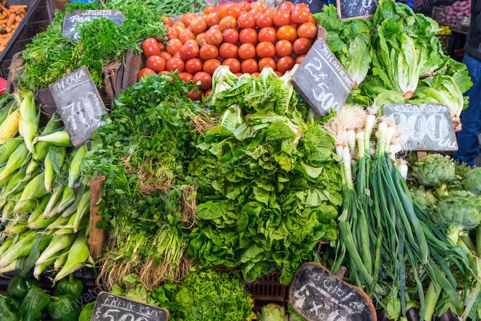 Lettuce, corncob and tomatoes for sale