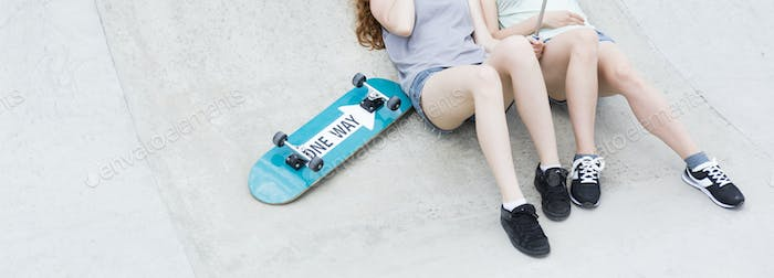 Female skateboarders in skatepark