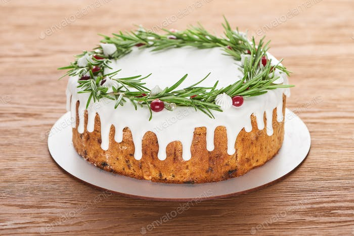 Christmas Pie With Rosemary And Cranberries on Plate on Wooden Table