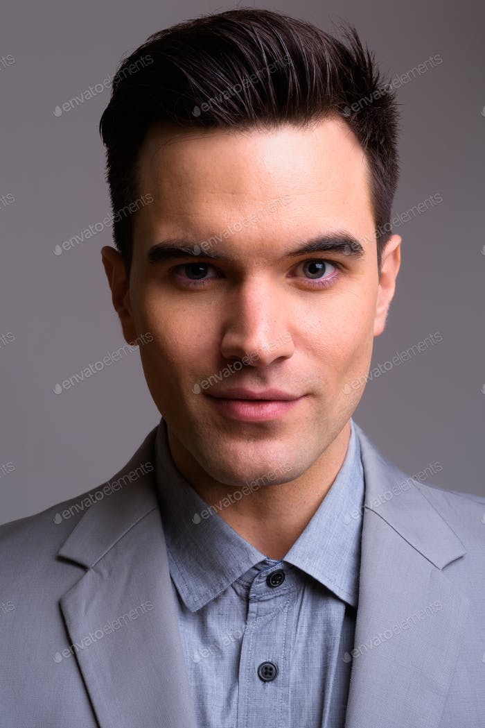 Face of young handsome businessman in suit