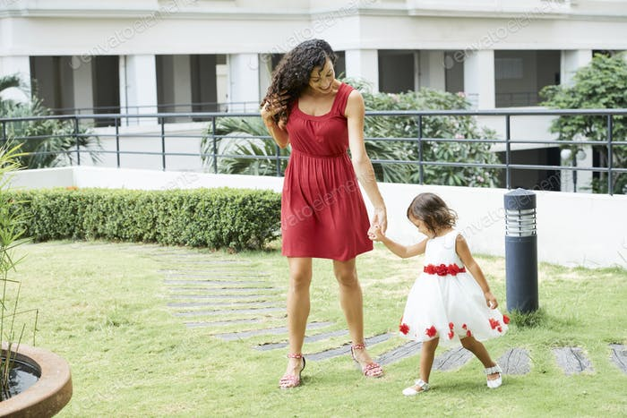 Mother Walking with Little Daughter