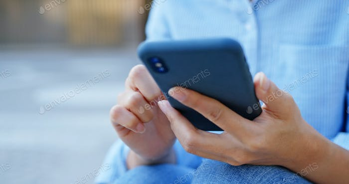 Woman use of cellphone at street