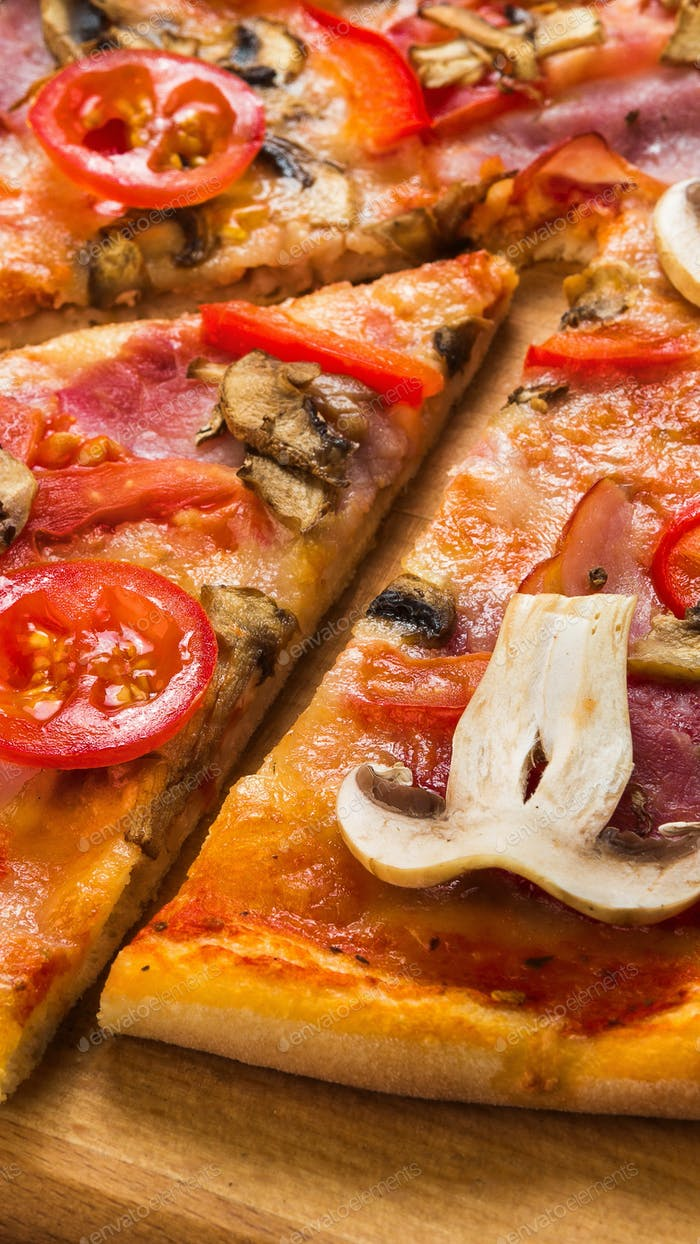 Close up of Delicious pizza piece with mushrooms and pepperoni