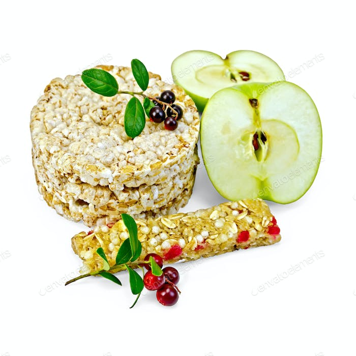 Granola bar and bread with lingonberries and apples