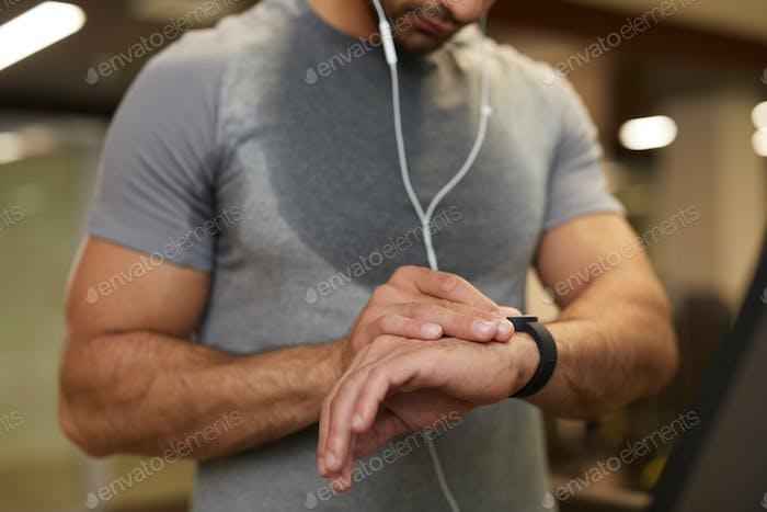 Man Using Smartwatch in Gym Closeup