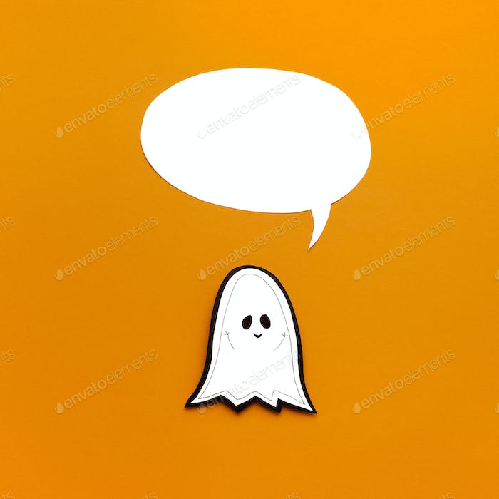 Smiling paper ghost with empty speech bubble for tag