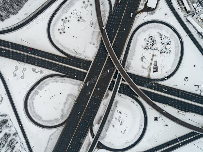 Aerial view of a freeway intersection Snow-covered in winter.