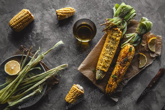 Grilled corn cobs with sauce, coriande. Mexican food. Top view. Copy space, healthy food, vegetables