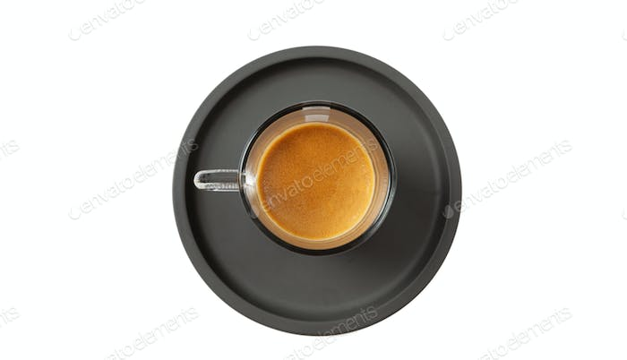 Espresso coffee on black saucer isolated on a white background, top view