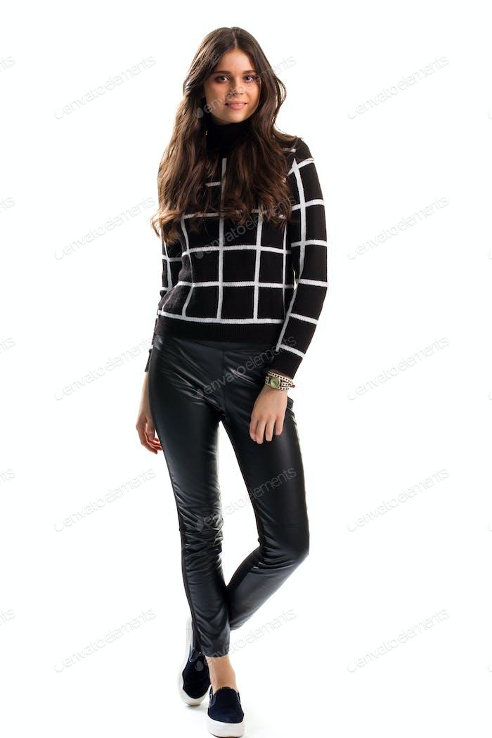 Woman in black checkered sweatshirt