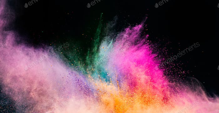 Holi powder blowing up on black background.