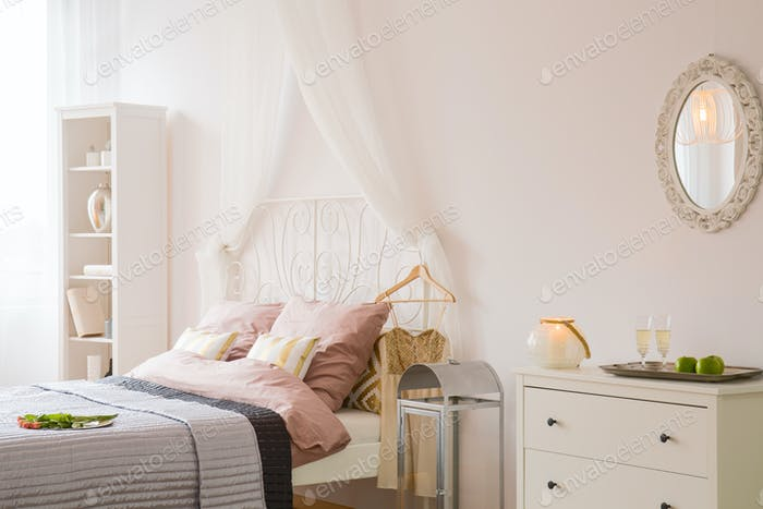 Room with bed and dresser