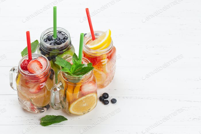 Fresh lemonade with summer fruits and berries