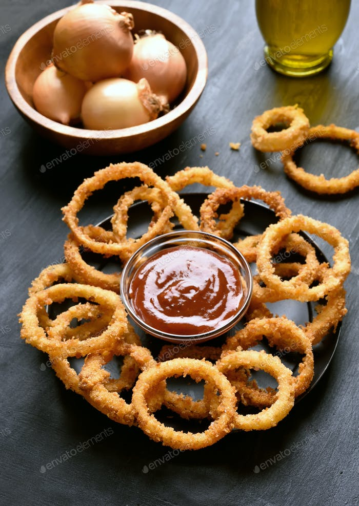 Fried onion rings and ketchup