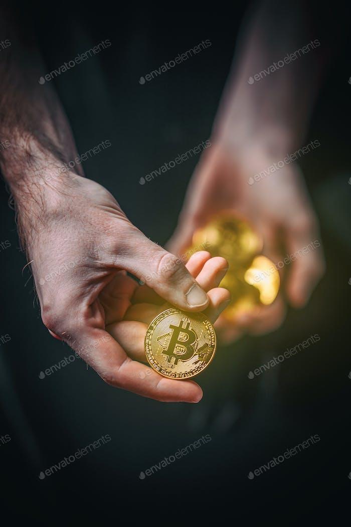 Man holding Bitcoin.