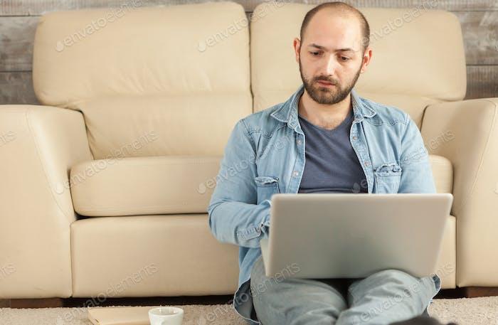 Adult man using laptop