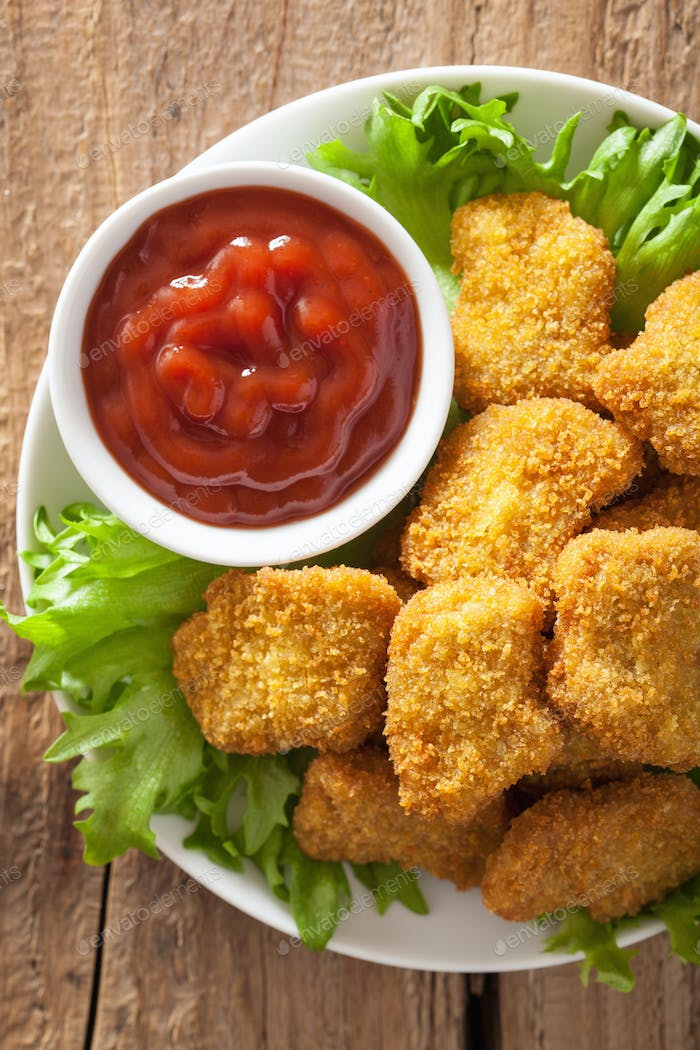 chicken nuggets with ketchup