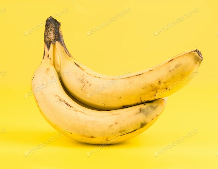 bananas isolated on yellow background