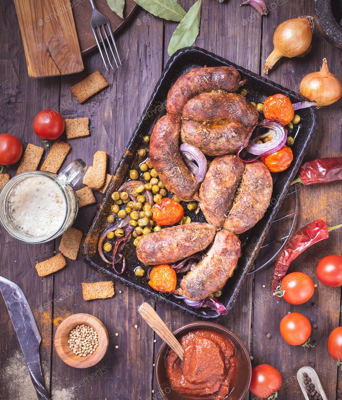 Homemade beef sausages on table