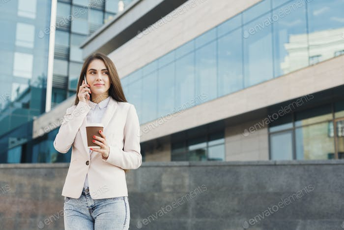 Portrait of a confident young businesswoman talking on cell