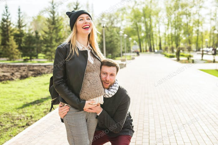 Stylish pregnancy concept - portrait of couple of hipsters husband and wife