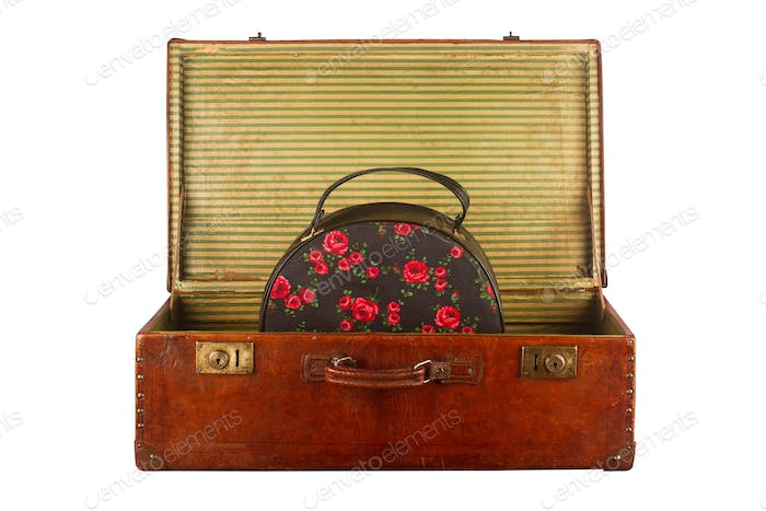 Old vintage suitcase with hand luggage