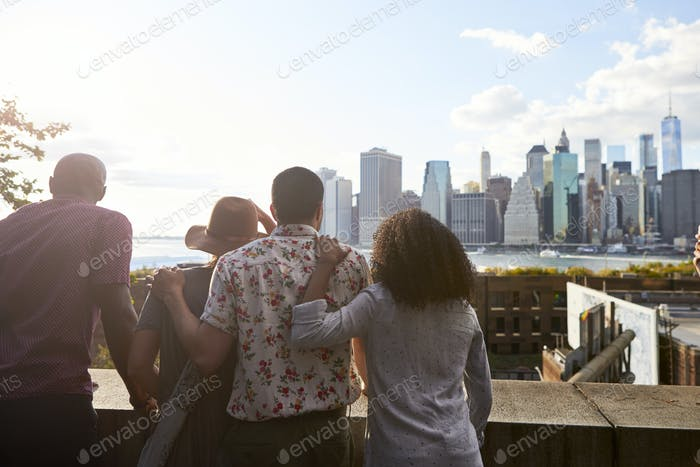 Rear View Of Tourists Looking At Manhattan Skyline