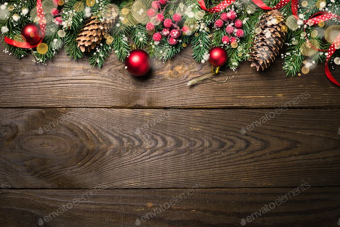 Christmas fir tree and decorations on wooden table