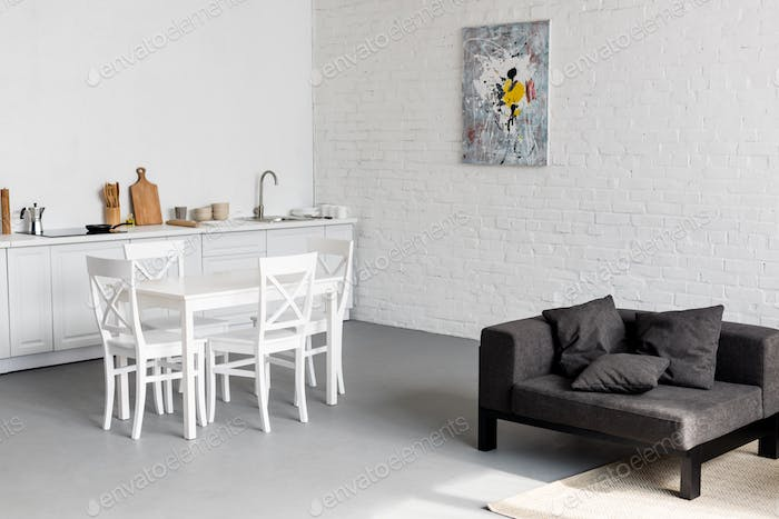 dining table on kitchen at modern studio apartment