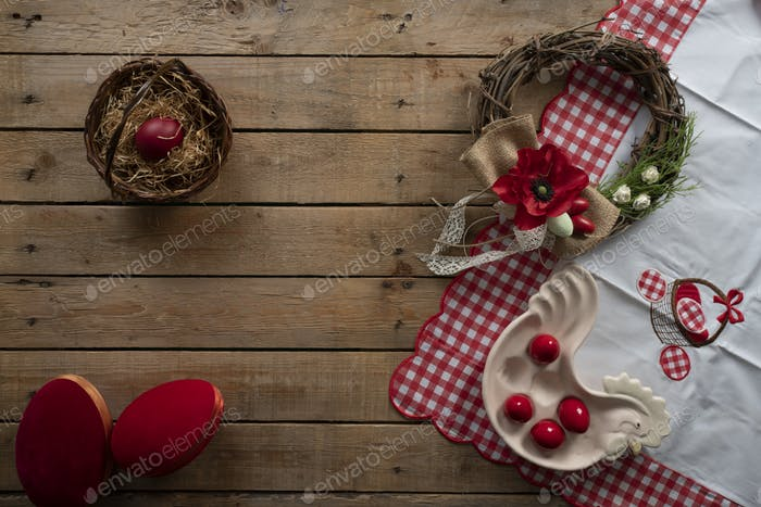 Easter background with easter tablecloth, decorative wreath, decorative eggs