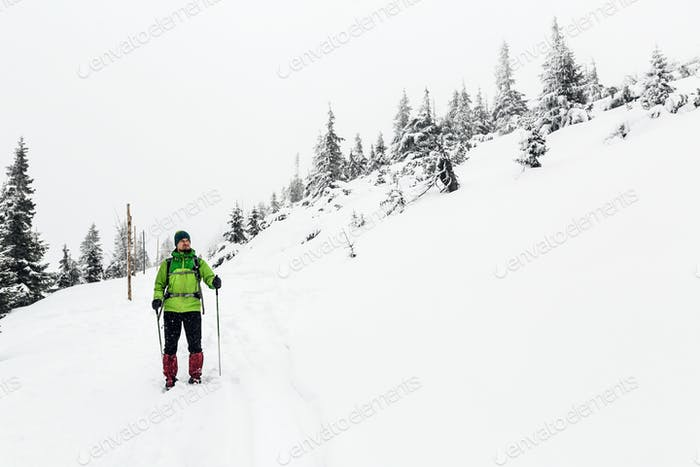Winter hike in white, man and adventure concept