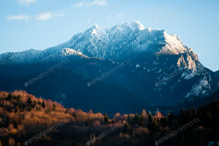 rocky mountain in autumn evening