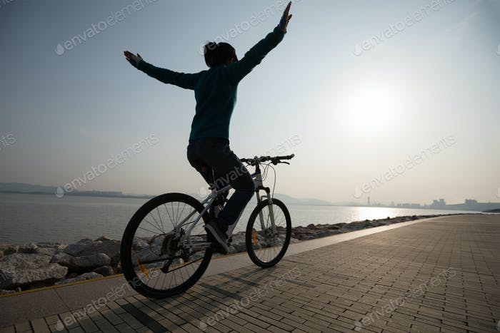 Cycling with arms outstretched