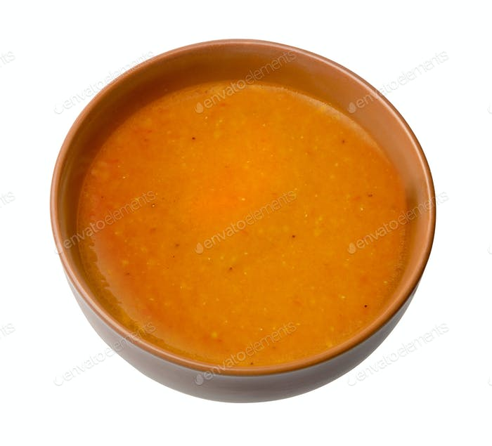 Bowl of squash soup isolated on a white background