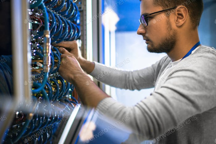 Engineer Working with Servers