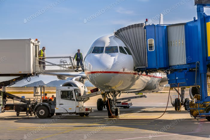 Passenger jet airplane docked at gate
