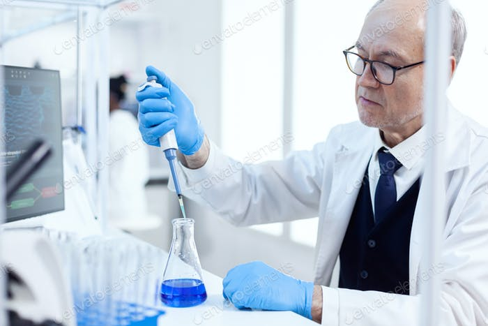 Experienced scientist working in biotechnological laboratory