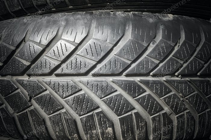 Close up picture of a used car tire.
