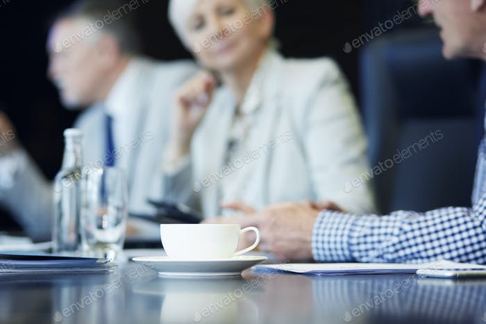 Cup of coffee on the conference table